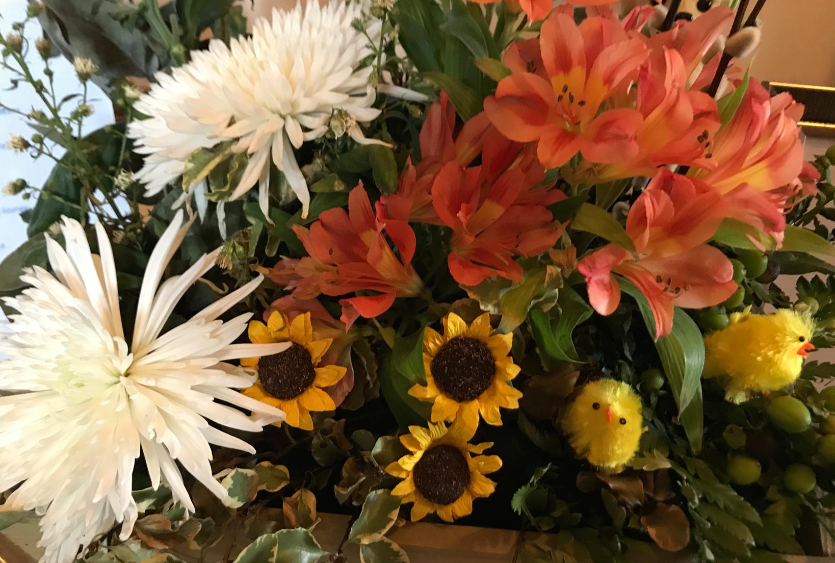 Easter chicks in spring flowers