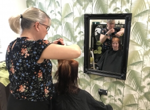 Carer has her hair cut at Fairfield's Carers Day