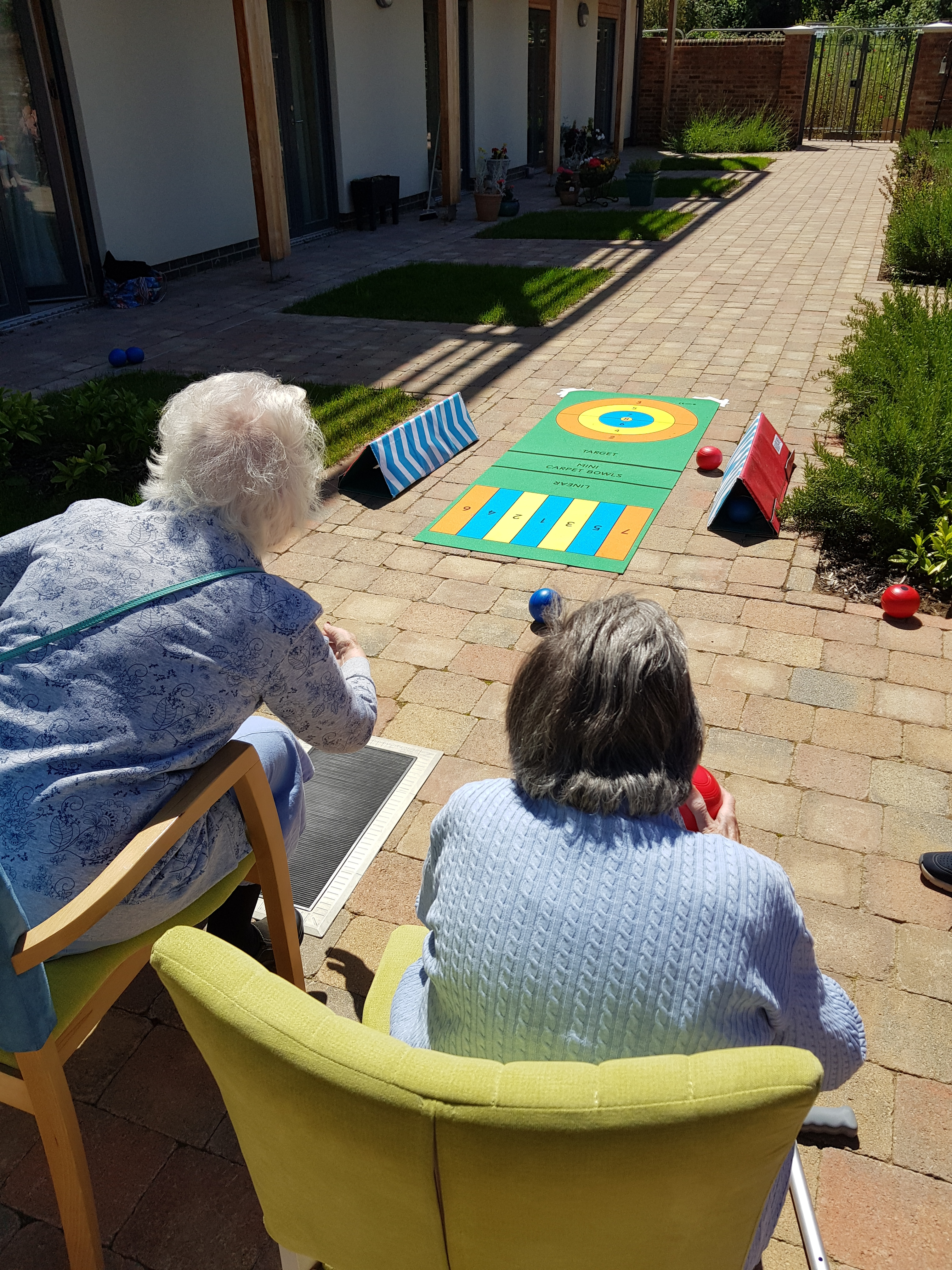 Residents bowling in the garden at Fairfield